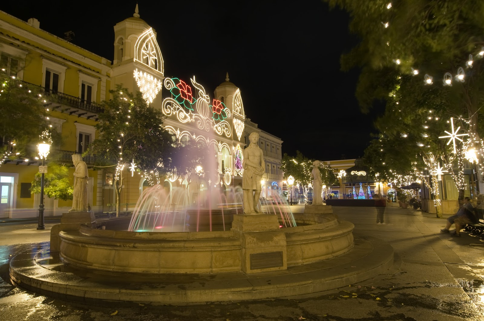 A Fountain among Christmas Light in a San Juan public square.